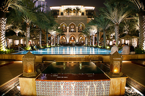 Hospitality industry at its peak is a luxurious hotel with palm trees and a pool