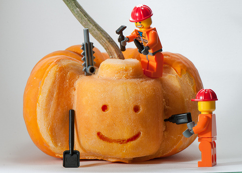 lego construction workers carve a pumpkin for their construction resume