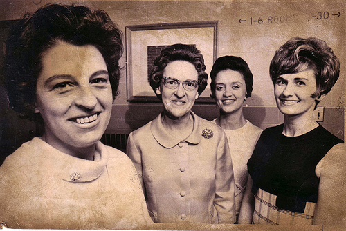 old picture, four smiling teachers